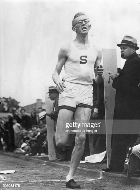 The American runner Ben Eastmann running new 500 meter world record About 1932 Photograph