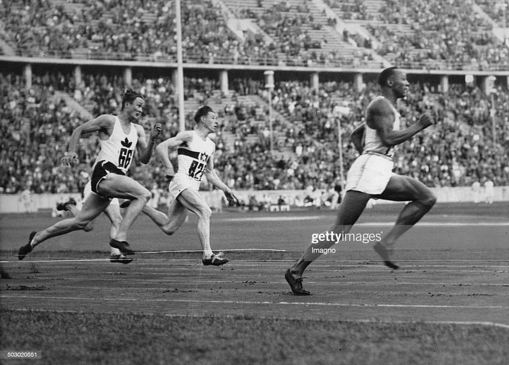 The American Runner Jesse Owens Running In The 200-Meter Sprint A New Olympic Record. Berlin. 4Th August 1936. Photograph. : News Photo