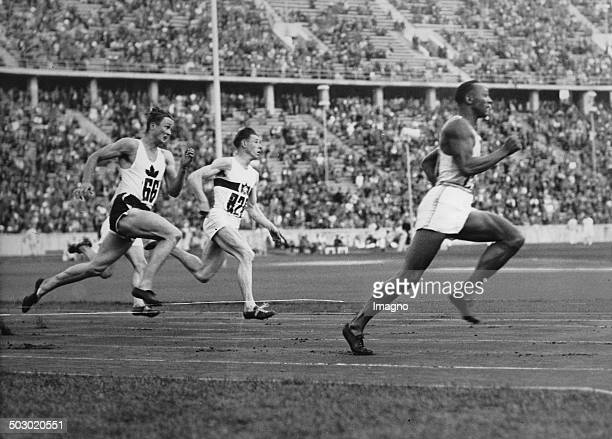 The American runner Jesse Owens running in the 200meter sprint a new Olympic record Berlin 4th August 1936 Photograph