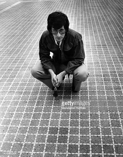 The American scriptwriter and movie producer Steven Spielberg crouching 1975