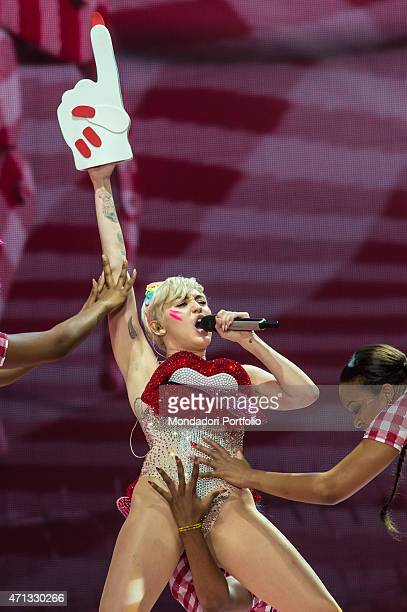 The American singer Miley Cyrus sings during a concert at the Mediolanum Forum She wears a bodysuit with a big mouth on chest and dancing in a...