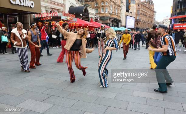 The American Soul crew seen dancing together in the streets of London In honour of the BET Networks groovy new period drama American Soul a flash mob...