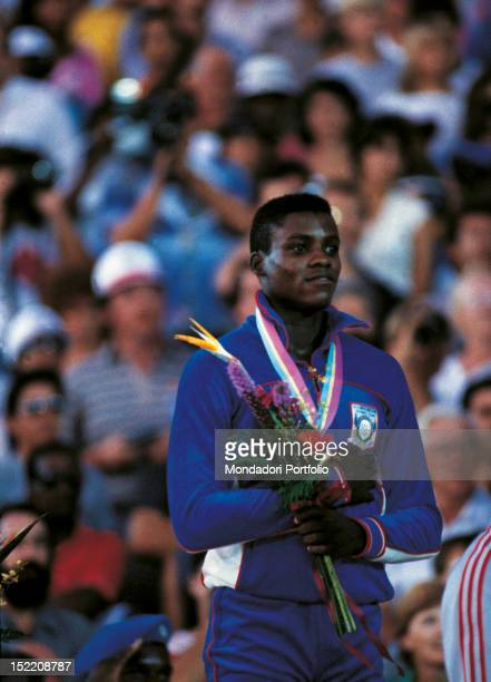 The American sprinter and long jumper Carl Lewis attending a prizegiving ceremony of a race won at Los Angeles Olympics Los Angeles august 1984