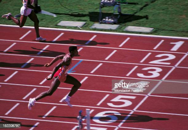 The American sprinter and long jumper Carl Lewis crossing the finish line of a race at Los Angeles Olympics. Los Angeles, August 1984