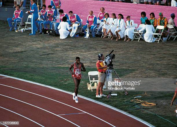 The American sprinter and long jumper Carl Lewis running on the track after winning a race at Los Angeles Olympics Los Angeles August 1984