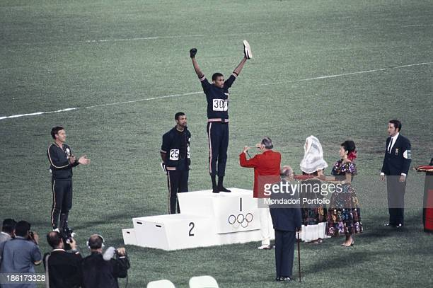 The american sprinters Tommie Smith John Carlos and Peter Norman during the award ceremony of the 200 m's race at the Mexican Olympic games During...