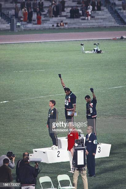 The american sprinters Tommie SmithJohn Carlos and Peter Norman during the award ceremony of the 200 m race at the Mexican Olympic games During the...