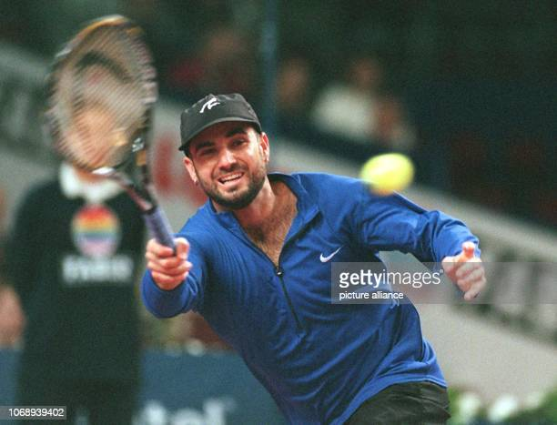 The American Tennis professional Andre Agassi plays the ball with his forehand quarterfinal against Pete Smapras Stuttgart Schleyer Hall pictured on...