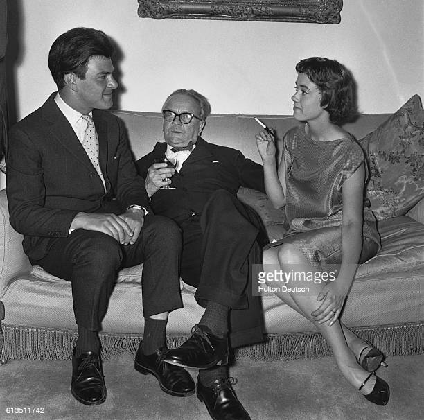 The American thriller writer Raymond Chandler sits with two friends including Mrs Anthony Blond