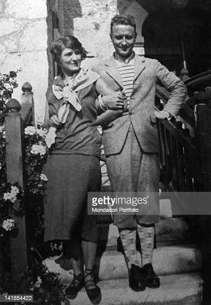 The American writer Francis Scott Fitzgerald and his wife Zelda Sayre posing arm in arm on a staircase. 1926