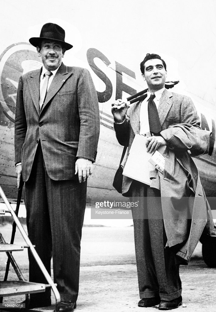 The American writer John STEINBECK and his friend Robert CAPA, the American photographer of Hungarian origin, posing before boarding a plane on July 29, 1947.