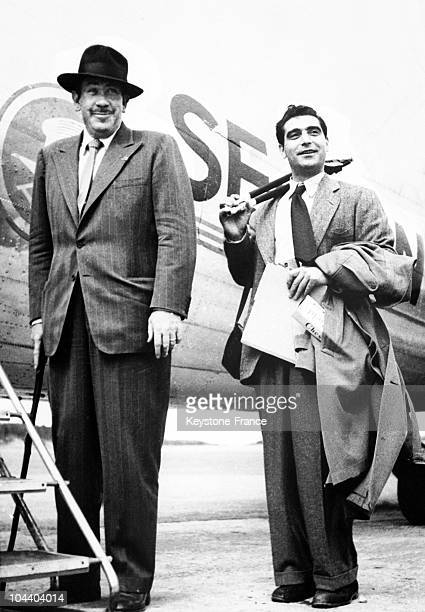 The American writer John STEINBECK and his friend Robert CAPA the American photographer of Hungarian origin posing before boarding a plane on July 29...