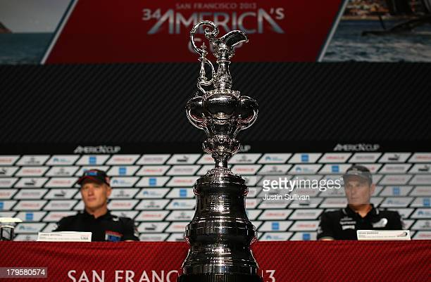 The America's Cup trophy is displayed during a news conference with Emirates Team New Zealand skipper Dean Barker and Oracle Team USA skipper James...