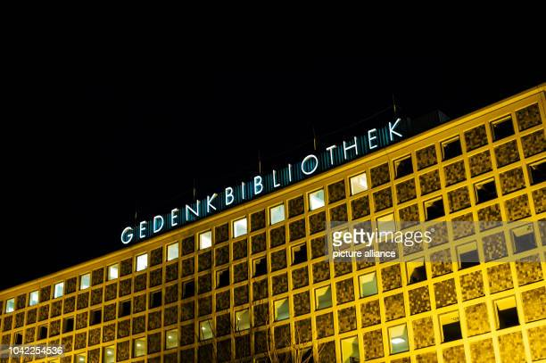 The AmerikaGedenkbibliothek is illuminated in Berlin Germany 07 January 2014 Photo Paul Zinken/dpa | usage worldwide