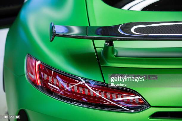 The AMG marque badge sits on the boot of a newly assembled green MercedesBenz AG AMG GT R high performance luxury automobile during final checks at...