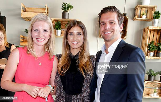 The Amorelie founder LeaSophie Cramer and Sebastian Pollok with Cathy Hummels during the Amorelie Wonderland dinner party at their new headquarter on...