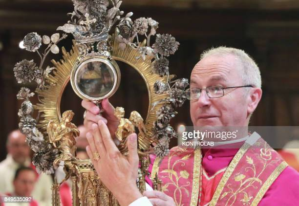 The ampoule with the blood during the ceremony for the solemnity of San Gennaro The 'Miracle' of San Gennaro was repeated when the blood of Naples'...