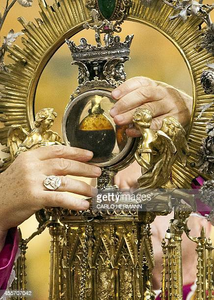 The ampoule with the blood melted is exposed during the celebrations of Saint Januarius on September 19 2014 in the Cathedral of Naples Saint...