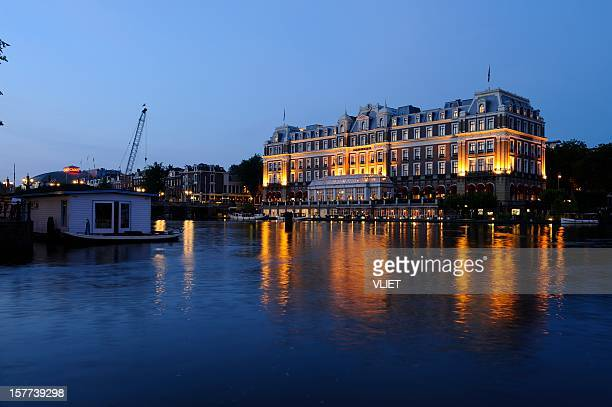 The Amstel Hotel in Amsterdam at dusk