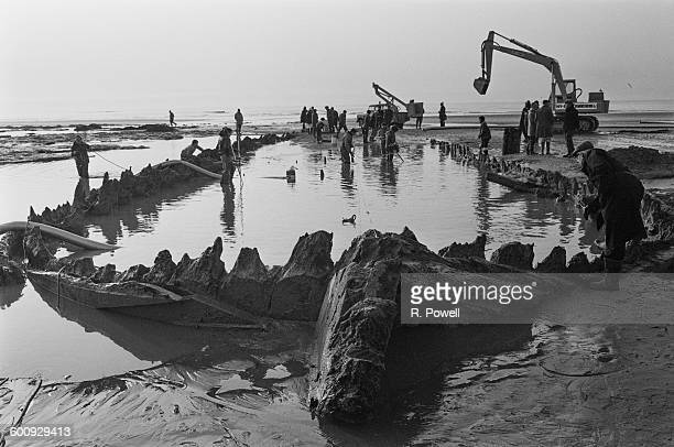 The 'Amsterdam' an 18th century cargo ship of the Dutch East India Company is uncovered in the muddy shore at Bulverhythe near Hastings in East...