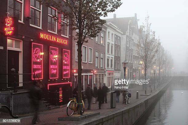 The Amsterdam Red Light District covers a large area of the oldest part of the city. The buildings are tall, thin and crowd together, overlooking the...