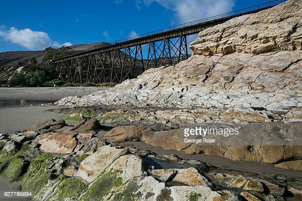 The Amtrak train trestle crosses the canyon and sandy beach as viewed on November 26 in Gaviota State Park California Because of its close proximity...