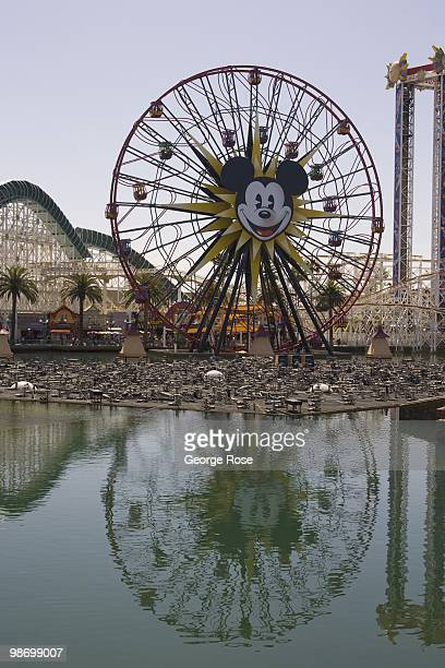 The amusement park at Paradise Pier with California Screamin' roller coaster and Mickey's Fun Wheel in Disney's California Adventure are viewed in...