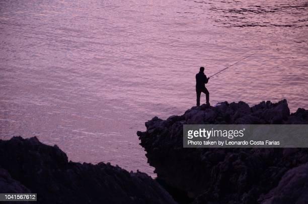 the anacapri fisherman - leonardo costa farias stock photos and pictures