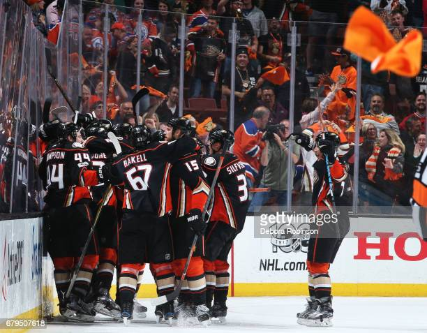 The Anaheim Ducks celebrate their 43 win after double overtime against the Edmonton Oilers in Game Five of the Western Conference Second Round during...