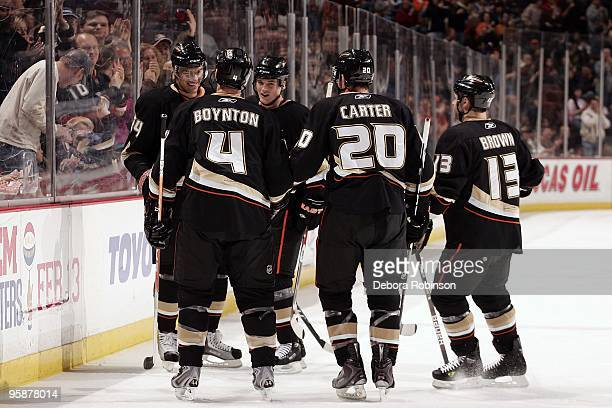 The Anaheim Ducks congratulate teammate Evgeny Artyukhin for a goal against the Calgary Flames during the game on January 17 2010 at Honda Center in...