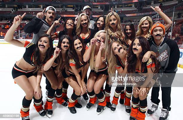 The Anaheim Ducks Power Players Ice Crew pose for a group photo with their moustache's as part of 'Movember' month after the game against the Chicago...