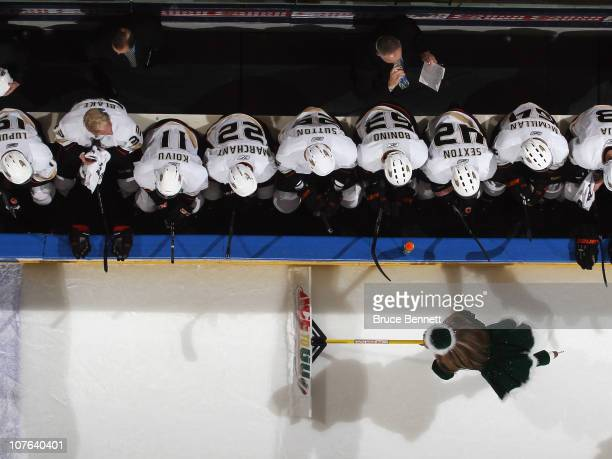 The Anaheim Ducks sit on the bench during a timeout as an ice girls cleans the ice during the game against the New York Islanders at the Nassau...