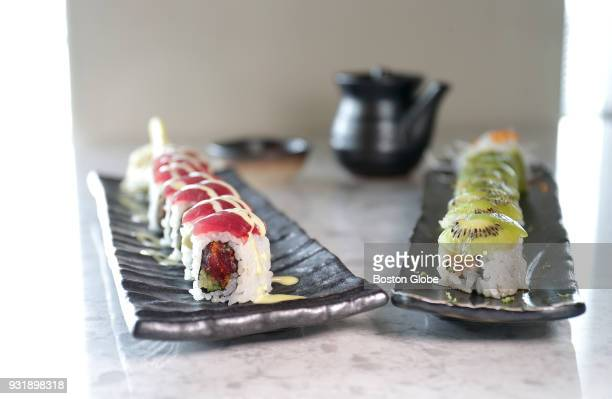 The Anata Roll with spicy tuna scallion sriracha togarashi cucumber tempura flakes and shiso topped with tuna and wasabi aioli left and the Green...
