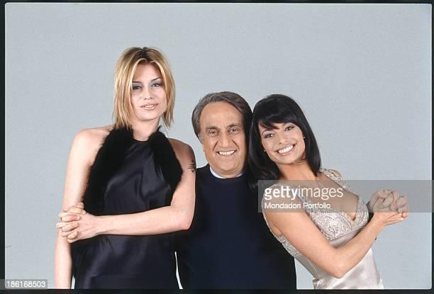 The anchorman Emilio Fede is smiling between two showgirls Elenoire Casalegno and Natalia Estrada Italy 1999