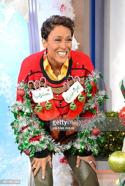 AMERICA The anchors compete in the Ugly Sweater contest on GOOD MORNING AMERICA 12/16/13 airing on the ABC Television Network ROBIN