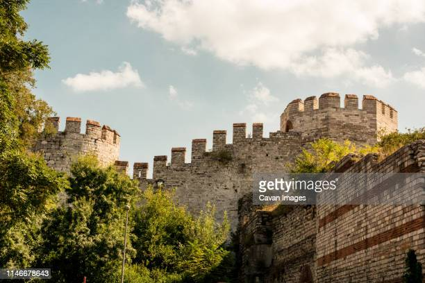 the ancient city walls of constantinople in istanbul, turkey - castle wall stock pictures, royalty-free photos & images