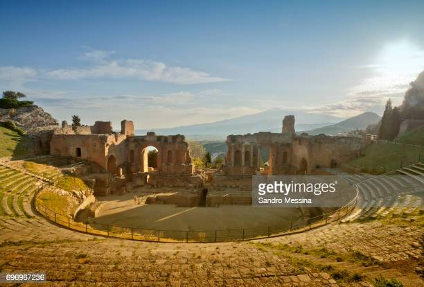 the ancient greek theater in taormina, italy - taormina stock photos and pictures