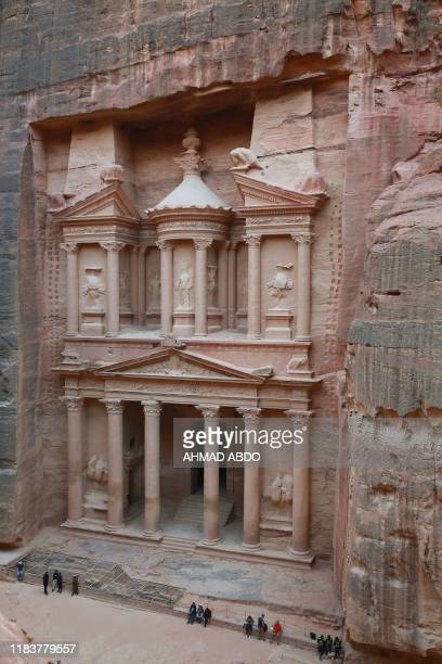 The ancient Khaznah monument carved in the rock cliff in Jordan's archaeological city of Petra south of the capital Amman on November 21 2019 Chosen...