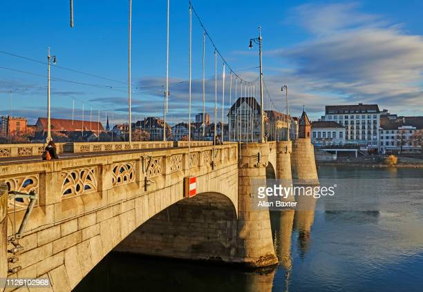 the ancient 'mittlere bruecke' (middle bridge) in basel at sunrise - basel port stock photos and pictures