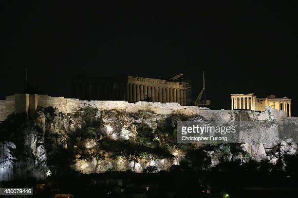 The ancient Parthenon temple on top of the Acropolis hill is seen only partially illuminated as Greece is due to submit new proposals to its...