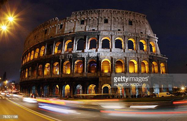 The ancient Roman Colosseum is illuminated to mark World AIDS Day 01 December 2007 in Rome The World Health Organization who started World AIDS Day...