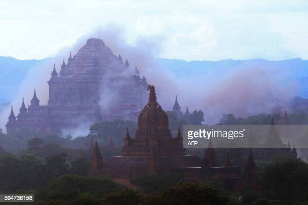 TOPSHOT The ancient Sulamani temple is seen shrouded in dust as a 68 magnitude earthquake hit Bagan on August 24 2016 A powerful 68 magnitude...