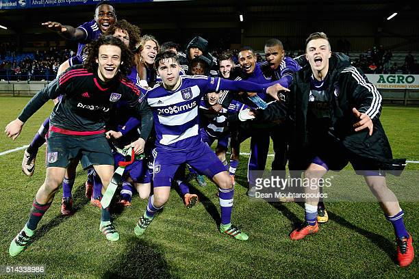 The Anderlecht team celebrate victory after the UEFA Youth League Quarter-final match between Anderlecht and Barcelona held at Van Roy Stadium on...
