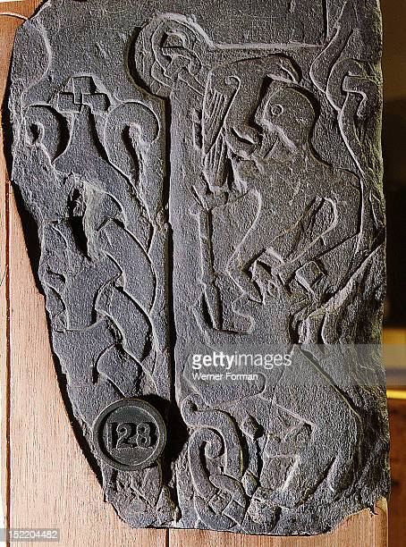 The Andreas Stone with a relief depicting a scene from the legendary Norse poem Ragnarok Doomsday of the Gods in which the god Odin is eaten by the...