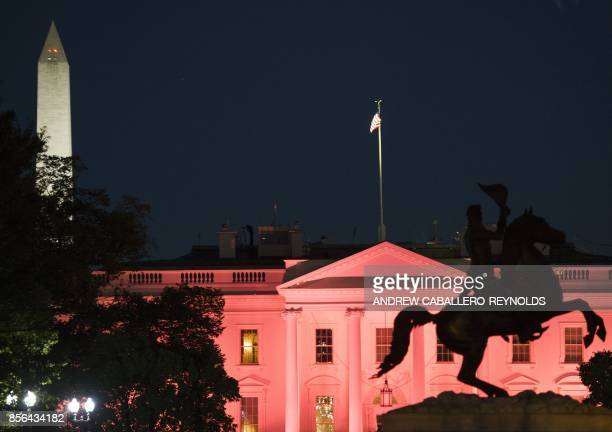 The Andrew Jackson Memorial is seen in Lafayette Square near the White House illuminated in pink for Breast Cancer awareness month with the...