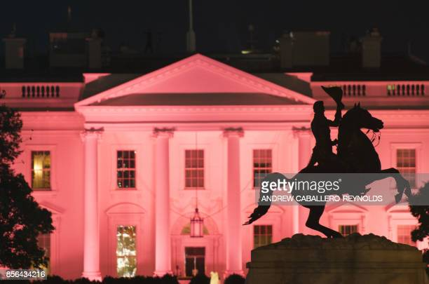 The Andrew Jackson Memorial is seen in Lafayette Square near the White House illuminated in pink for Breast Cancer awareness month in Washington DC...