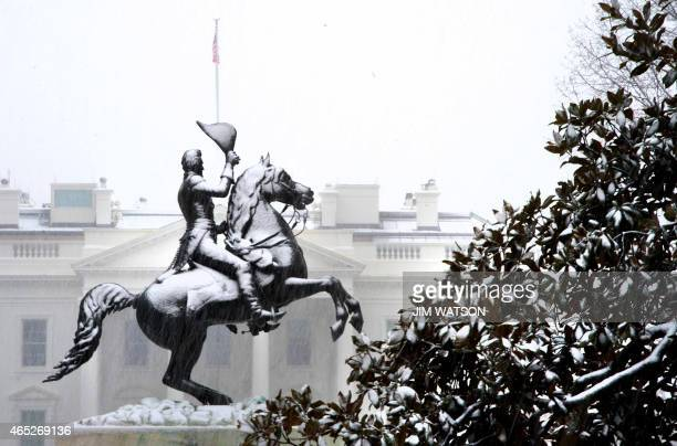 The Andrew Jackson statue becomes snowcovered in front of the White House in Washington DC March 5 2015 A major winter storm slammed parts of the...