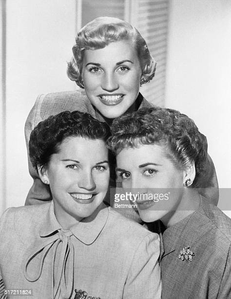 The Andrews Sisters brunettes Maxene and La Verne and blonde Patty harmonize three days a week on Columbia's five a week 'Club 15' musical a radio...
