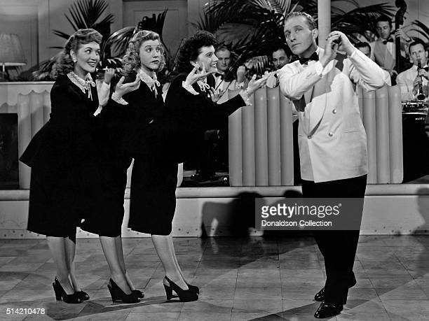 The Andrews Sisters perform with singer Bing Crosby in a scene from the movie The Road To Rio which was released in 1947