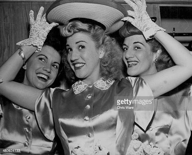 The Andrews Sisters posing for a photograph Maxene Patty and LaVerne circa 1940